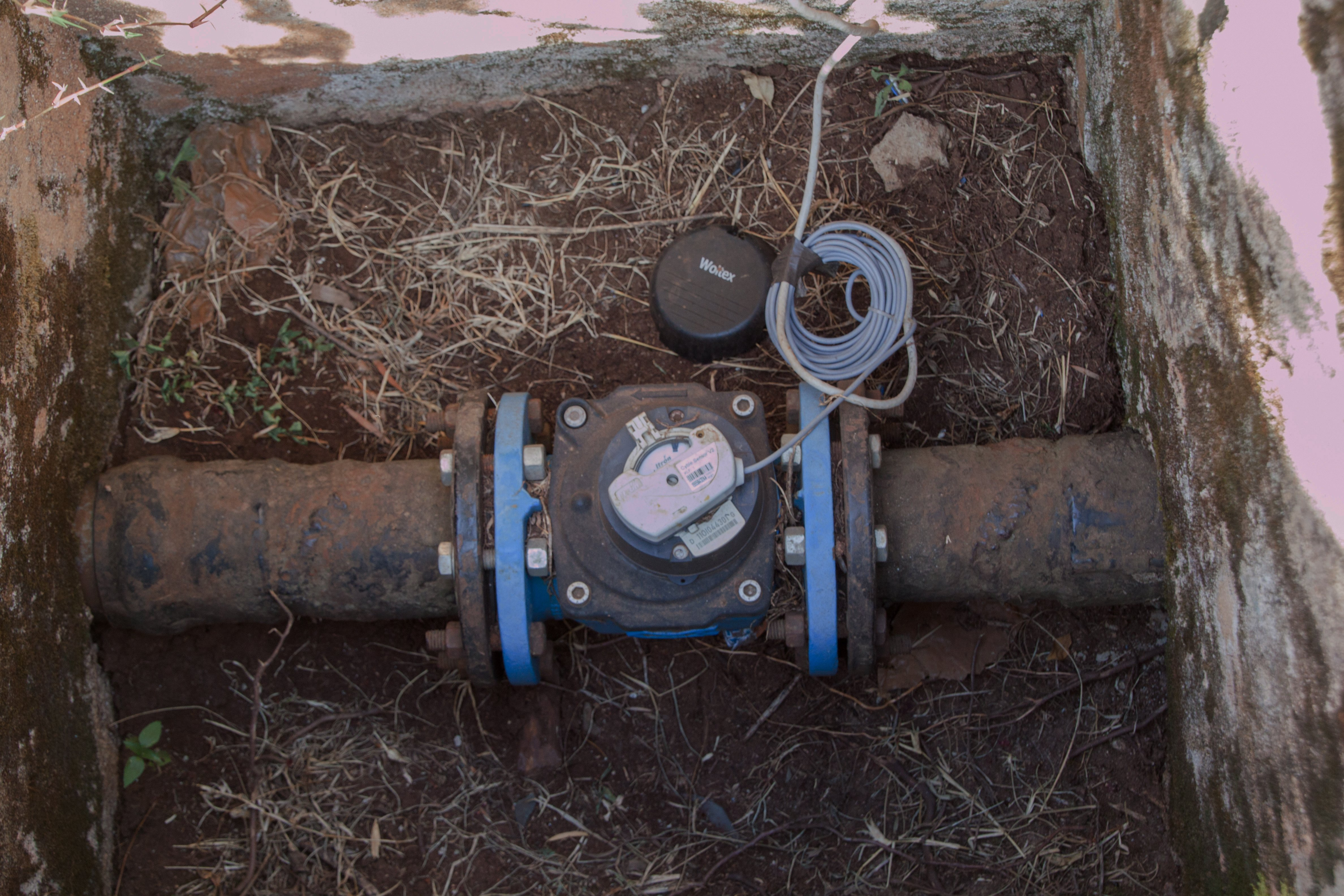 Retrofitting a water meter with sensors for flow monitoring